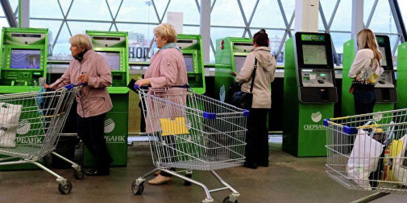 Россияне смогут оплачивать услуги ЖКХ картами Сбербанка на кассах магазинов